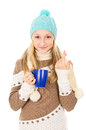 Teen girl in winter hat with cup isolated Royalty Free Stock Photos