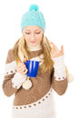 Teen girl in winter hat with cup isolated Royalty Free Stock Photo