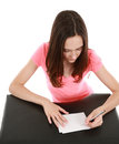 Teen girl writing on note cards