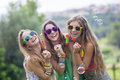 Teen girls blowing bubbles happy smiling gropu of Stock Photography