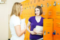 Teen Girls Between Classes Royalty Free Stock Images