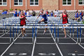 Teen Girls Competing in Hurdles Race Royalty Free Stock Images