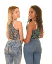 Teen girls posing in blue jeans Royalty Free Stock Photo