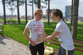 Teen girls preparing for a fun run teenagers the start of the usualy is part of marathon race the aim is to popularize healthy Royalty Free Stock Photos