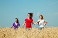 Teen girls running at the wheat field Royalty Free Stock Photo