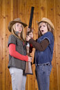 Teen girls with shotgun Royalty Free Stock Photography