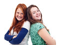 Teen girls standing back to back happy teenage and smiling Stock Image