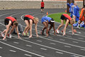 Teen Girls in Starting Blocks at High School Race Royalty Free Stock Images
