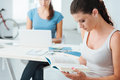 Teen girls studying at home Royalty Free Stock Photo