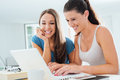 Teen girls studying with a laptop Royalty Free Stock Photo
