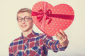 Teen guy with shape gift. Royalty Free Stock Photo