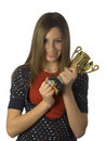 Teen holding trophy to chest Royalty Free Stock Image