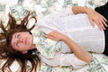 Teen holds money and dreams Stock Images