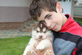 Teen with a husky puppy Royalty Free Stock Images