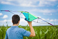 Teen with kite on a corn field Royalty Free Stock Photo