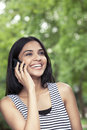 Teen laughing on phone Royalty Free Stock Photo