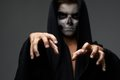 Teen with makeup skull cape wants grab to Stock Image