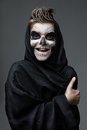 Teen with makeup skull showing thumbs up Royalty Free Stock Photo