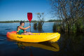 Teen making canoe kayak Royalty Free Stock Photo