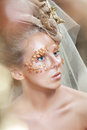 Teen model fashion beautiful glamour makeup and hairstyle glamor golden make up holiday gold makeup Stock Images