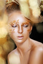 Teen model fashion beautiful glamour makeup and hairstyle glamor golden make up holiday gold makeup Royalty Free Stock Image