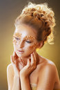 Teen model fashion beautiful glamour makeup and hairstyle glamor golden make up holiday gold makeup Royalty Free Stock Images