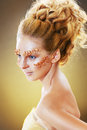 Teen model fashion beautiful glamour makeup and hairstyle glamor golden make up holiday gold makeup Royalty Free Stock Photo
