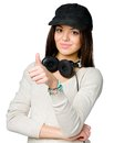 Teen in peaked cap thumbs up teenager black wearing headphones isolated on white Royalty Free Stock Photography