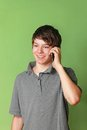 Teen at phone modern teenage boy talking into mobile Stock Photography