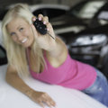 Teen in pink flashing carkey happy out of focus car key Royalty Free Stock Photography
