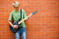 Teen playing guitar Stock Photography