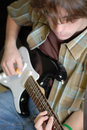 Teen playing guitar Royalty Free Stock Images