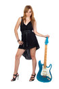 Teen rebellious girl with a electric guitar Royalty Free Stock Photography
