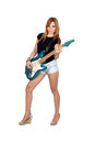 Teen rebellious girl playing electric guitar Royalty Free Stock Photo
