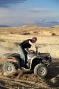 Teen riding quad ATV in the hills Royalty Free Stock Photography