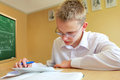 Teen in school doing classwork Royalty Free Stock Photo