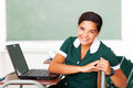 Teen school girl portrait of young sitting in class with laptop Royalty Free Stock Photos