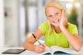 Teen schoolgirl homework happy doing at home Stock Images