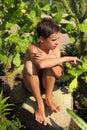 Teen sitting among cactus