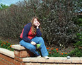 Teen sitting on the garden jamb Royalty Free Stock Photography