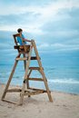 Teen sitting on lifeguard chair boy outdoor Stock Photo