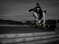 Teen skateboarder young teenager jumping with a longboard Royalty Free Stock Image