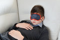 Teen sleeps during the day in mask for sleep Royalty Free Stock Photo