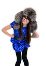 Teen in strict pose dressed blue dress glasses fur hat Royalty Free Stock Photo