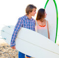 Teen surfer couple on beach shore with surfboards high key Stock Photography
