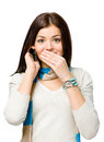 Teen talking on phone and covering her mouth with hand isolated white Royalty Free Stock Image