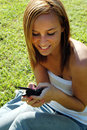 Teen using cell phone Stock Photo