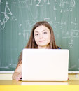 Teen using laptop student a in the classroom Royalty Free Stock Photography