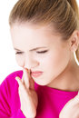 Teen woman having a terrible tooth ache pressing her bruised cheek with painful expression as if she s Stock Image