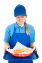 Teen worker disgusted by fast food meal Royalty Free Stock Photography